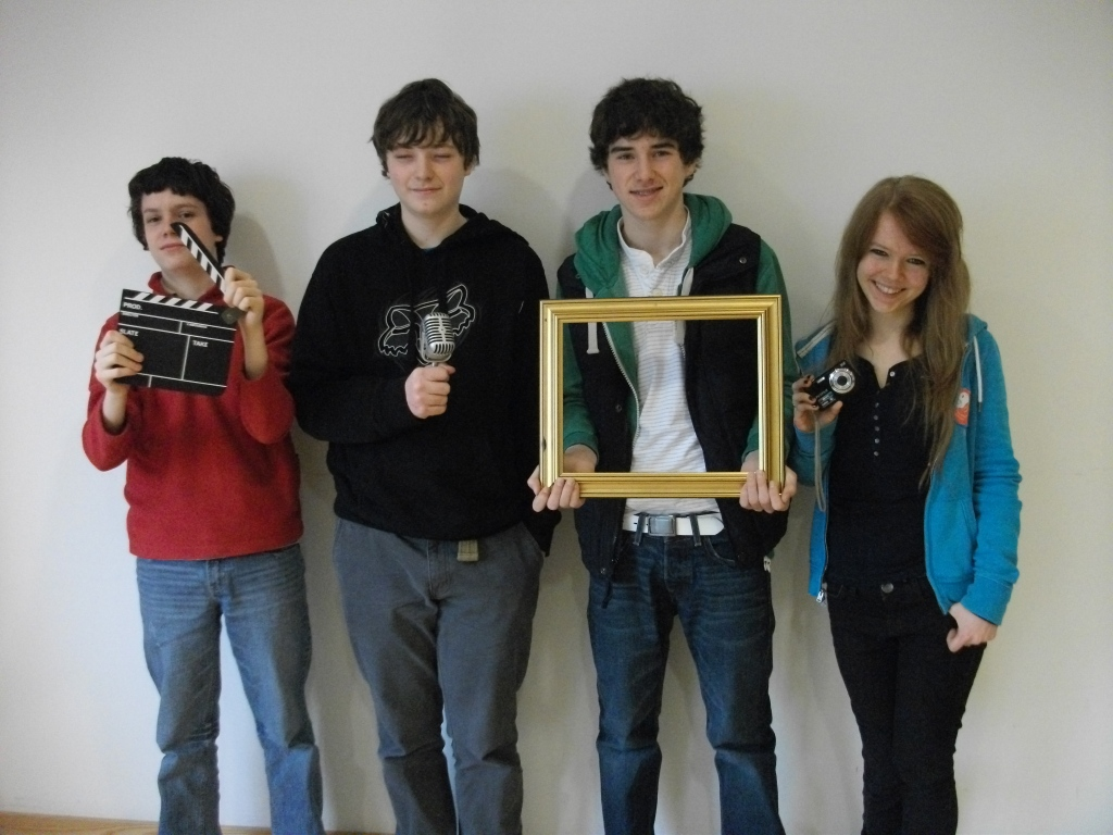 Four young people from a media project.