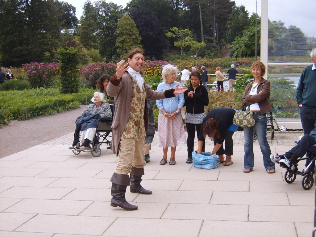 A performer in historical costume at RHS Wisley