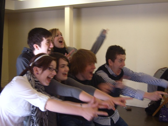 A group of students taking part in a drama workshop