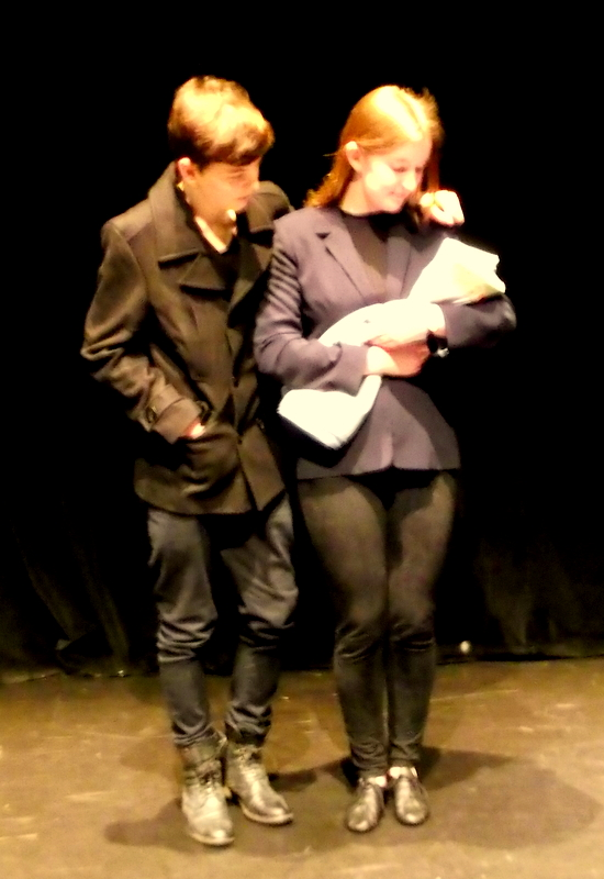 Two young actors perform in a studio theatre